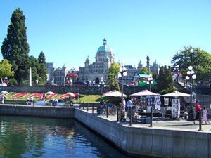 Victoria's exciting and busy Inner Harbour showing the BC Legislative Building